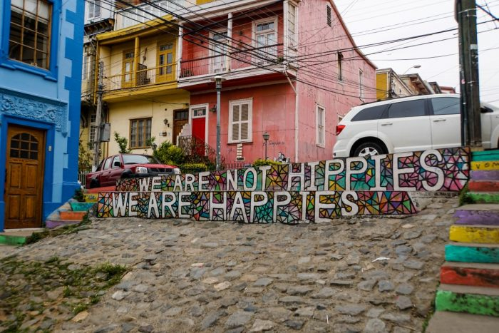 We are not hippies we are happies street art in Valparaiso, Chili