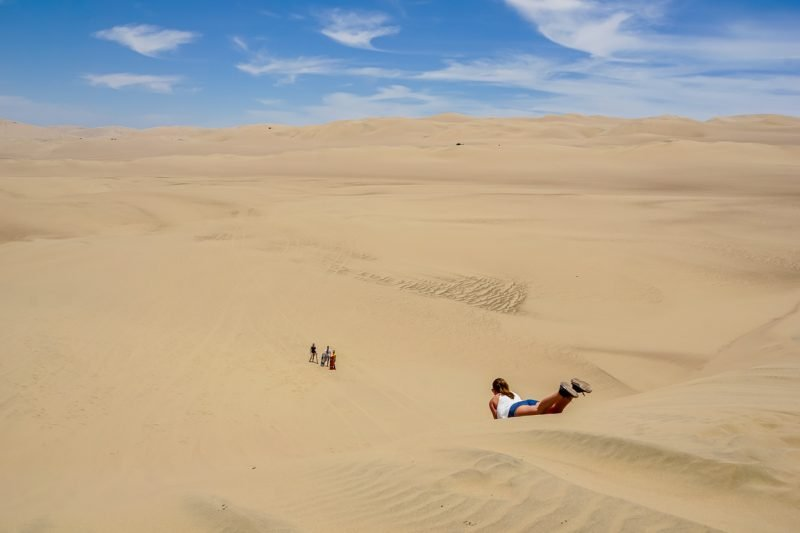 Sandboarden in Huacachina bij Ica, Peru